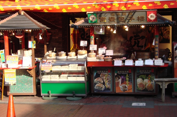 Dumpling stands on a Chinatown street