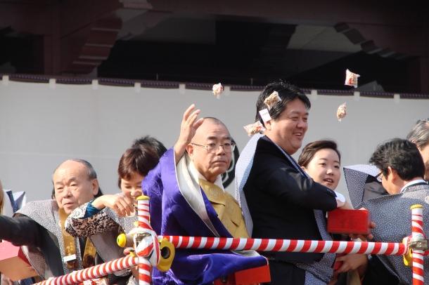 Priests throwing beans at Zojoji inTokyo