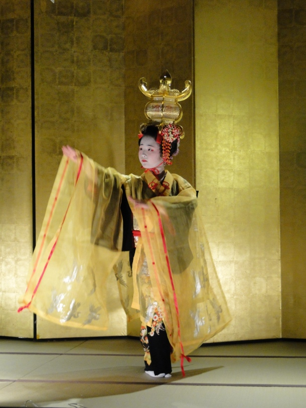 A young girl performing on the open stage in Yamaga