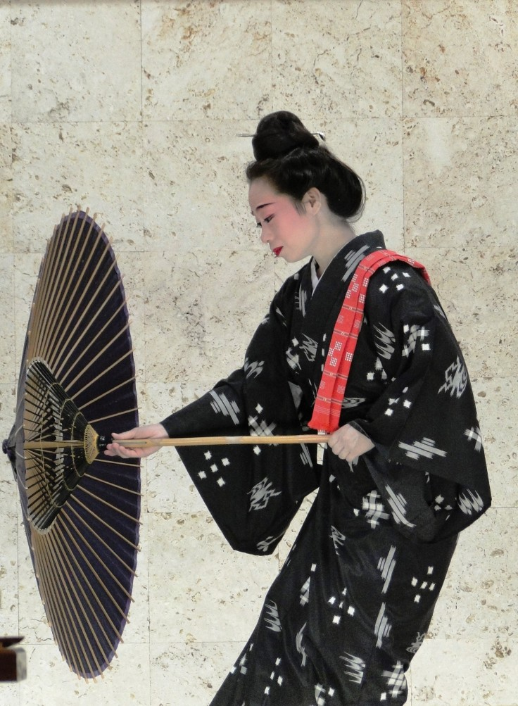 A woman performs the umbrella dance