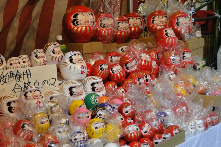 Daruma on sale at a year-end fair