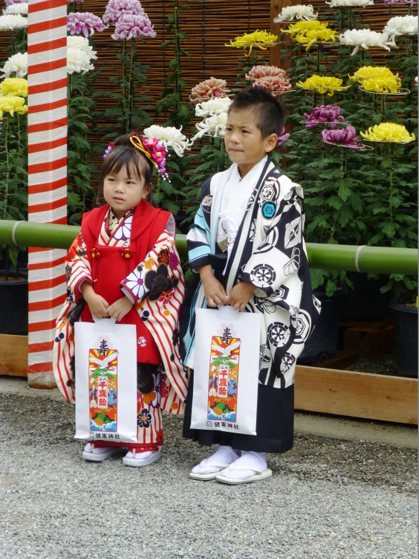 Two children pose for pictures at our local shrine's Shichi-go-san celebration