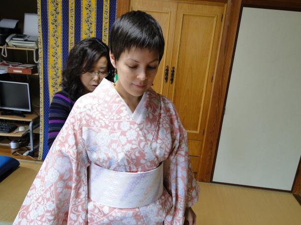 Putting on the obi-ita