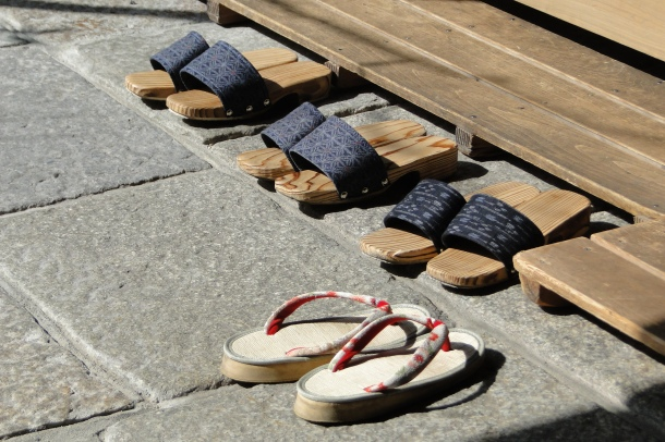 """Garden"" shoes lined up outside a restaurant in Kyoto"