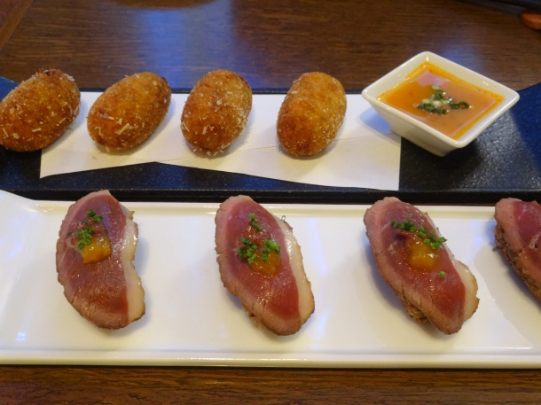 Blue cheese croquettes and duck tataki over almond rice