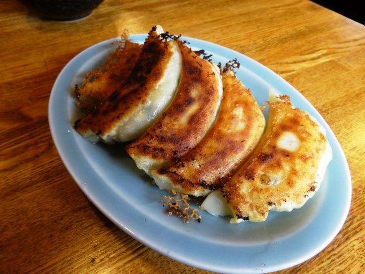 A plate of shrimp gyoza