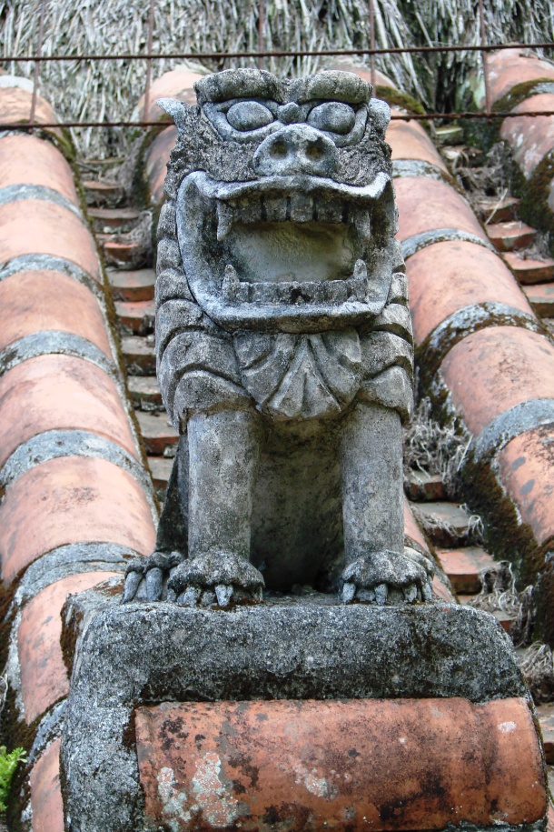 A sole shisa standing guard