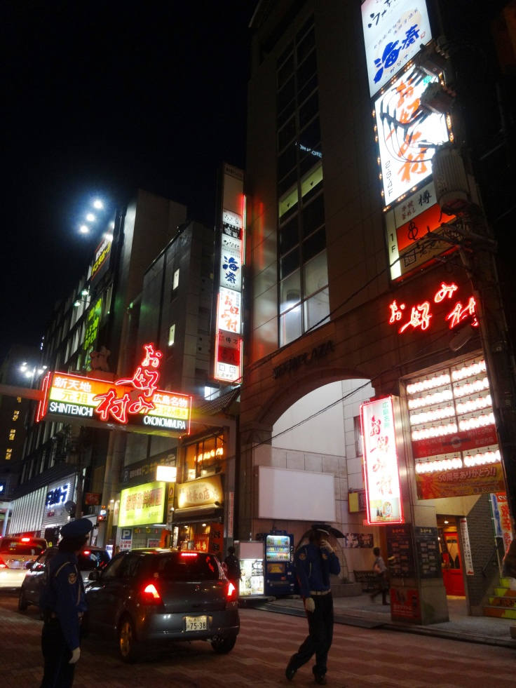 The Okonomimura building, all lit up at night