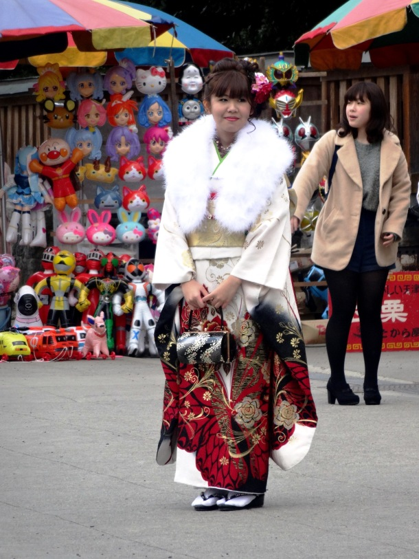 A girl poses for photos at Kengun Shrine on Coming of Age Day