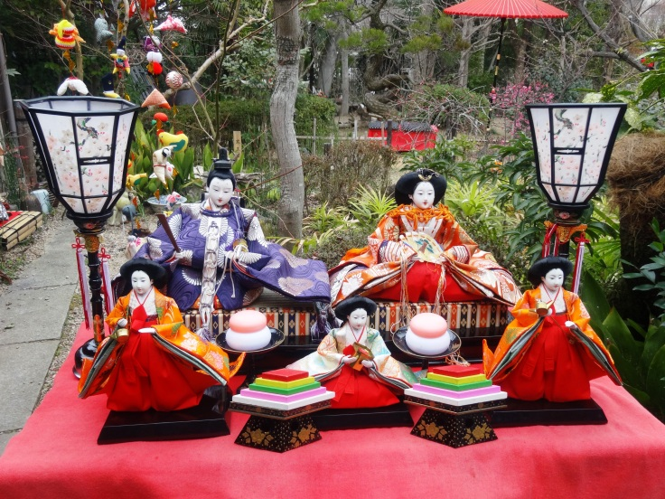 An outdoor Hina set, with plum blossoms in the background (right)