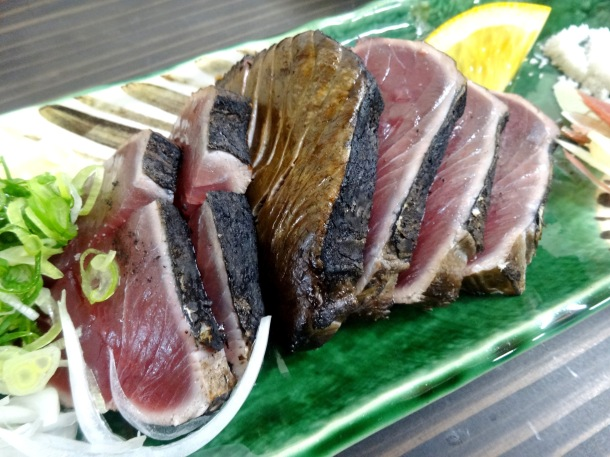 A portion of tataki, loaded up with toppings