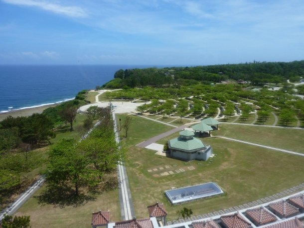 A view of the tiled roof (bottom of shot) and coast from a high floor of the Okinawa Prefectural Peace Memorial Museum