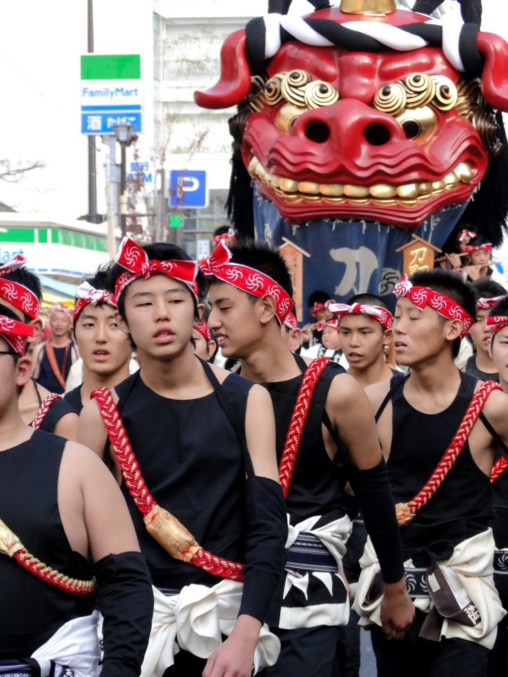 Participants at the Karatsu Kunchi festival sport tenugui on their heads