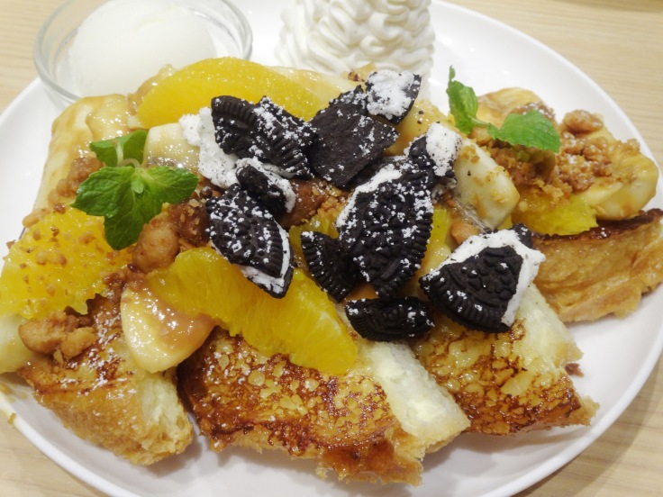My husband's full portion of the nutty caramel French toast ... with crumbled Oreos!